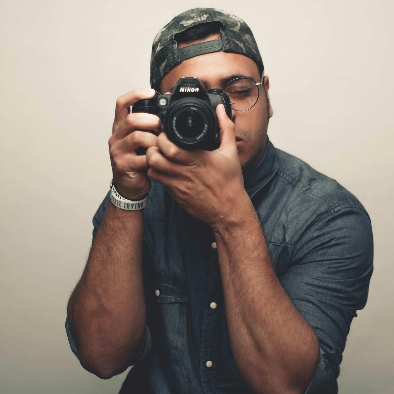 man-holding-camera-2941569