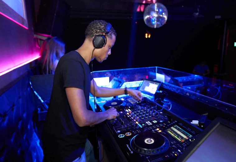 man-wearing-black-crew-neck-shirt-playing-dj-turntable-2123606