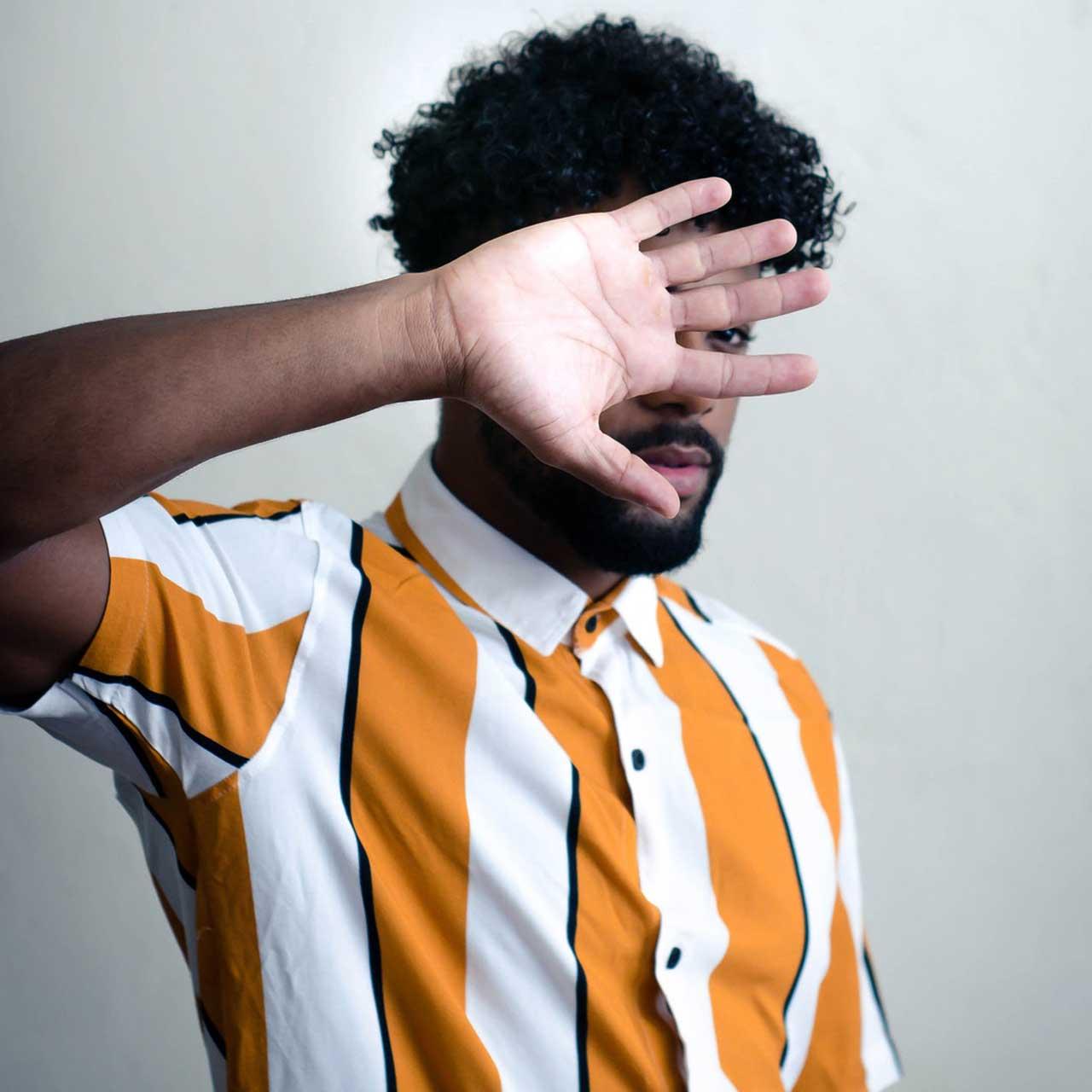 man-wearing-yellow-and-white-striped-shirt-3266351