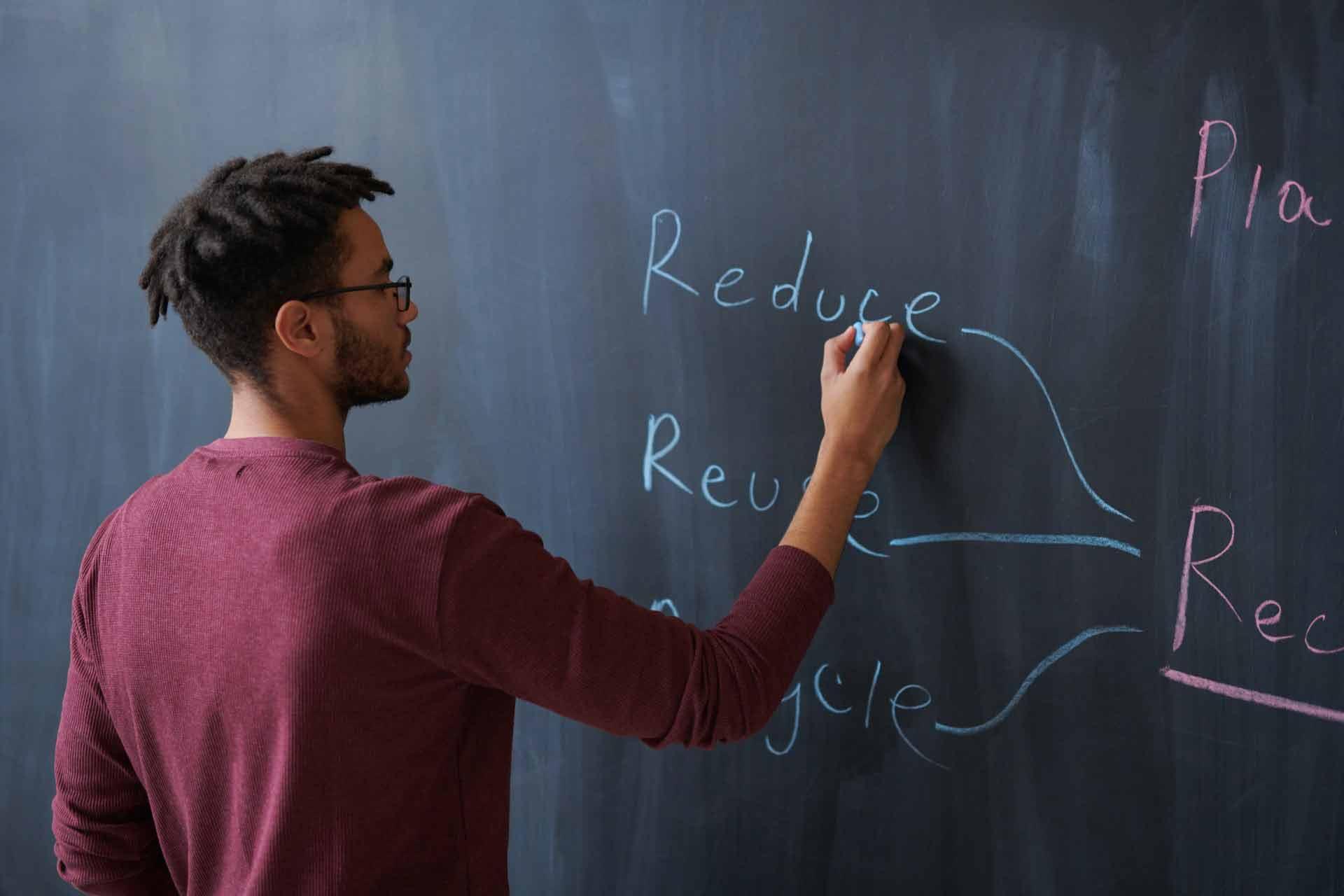 men-writing-on-board-3184633