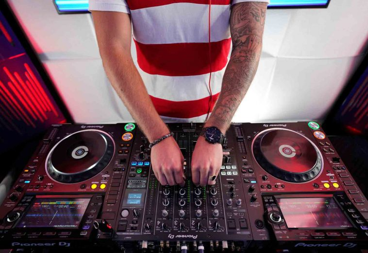 person-using-dj-mixer-2717073