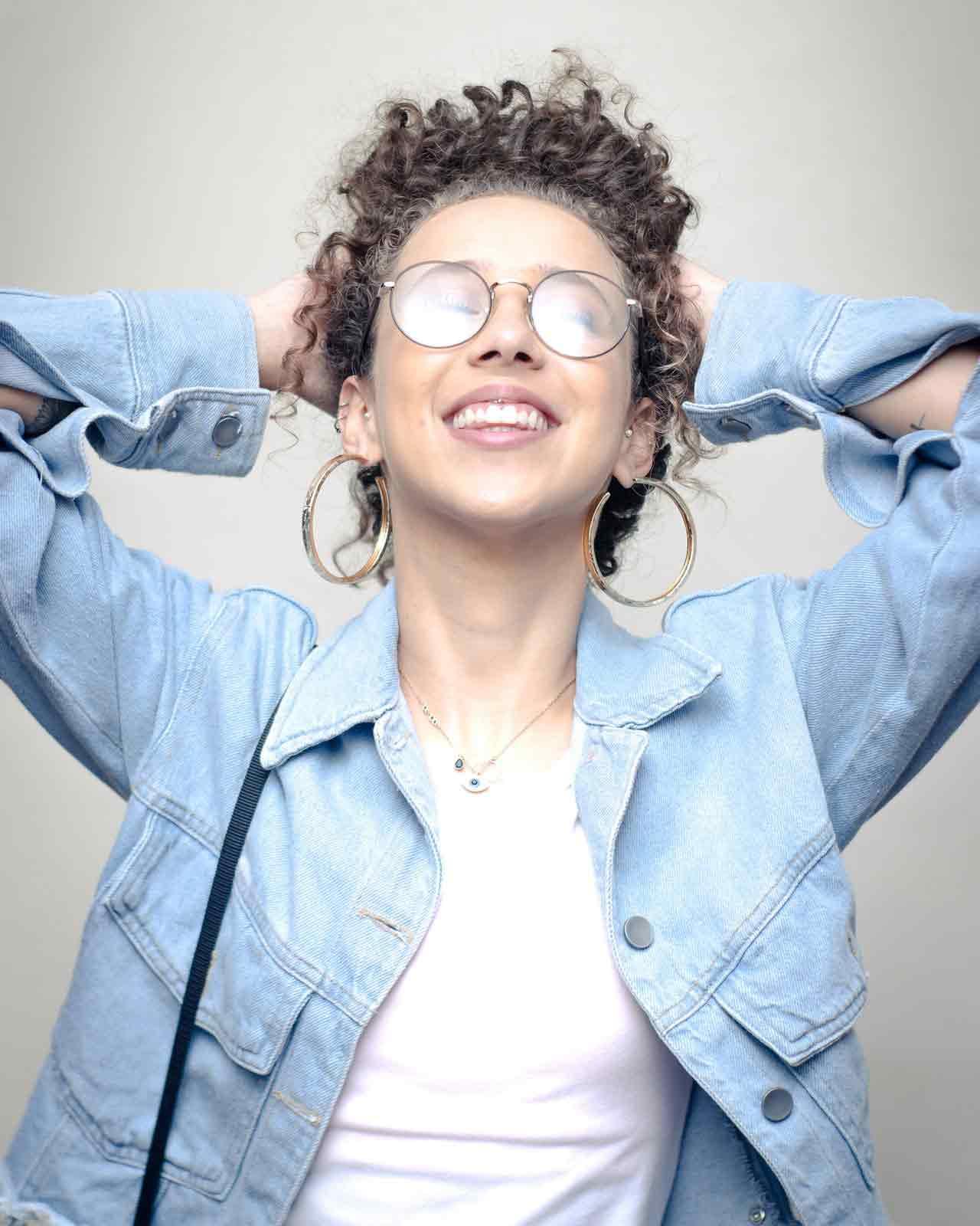 photo-of-woman-wearing-blue-denim-jacket-3341576