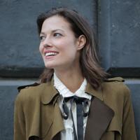 stylish-cheerful-woman-in-coat-on-street-3771343