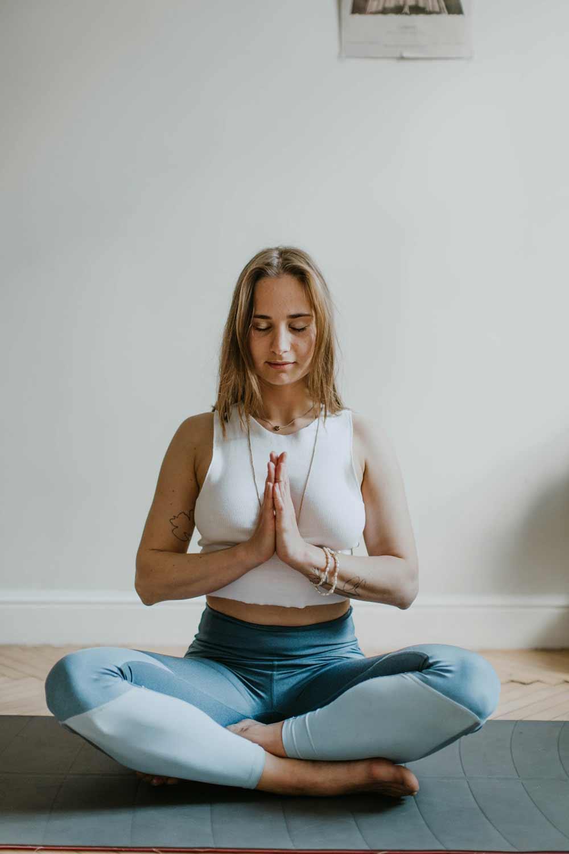woman-doing-yoga-inside-a-room-3094215