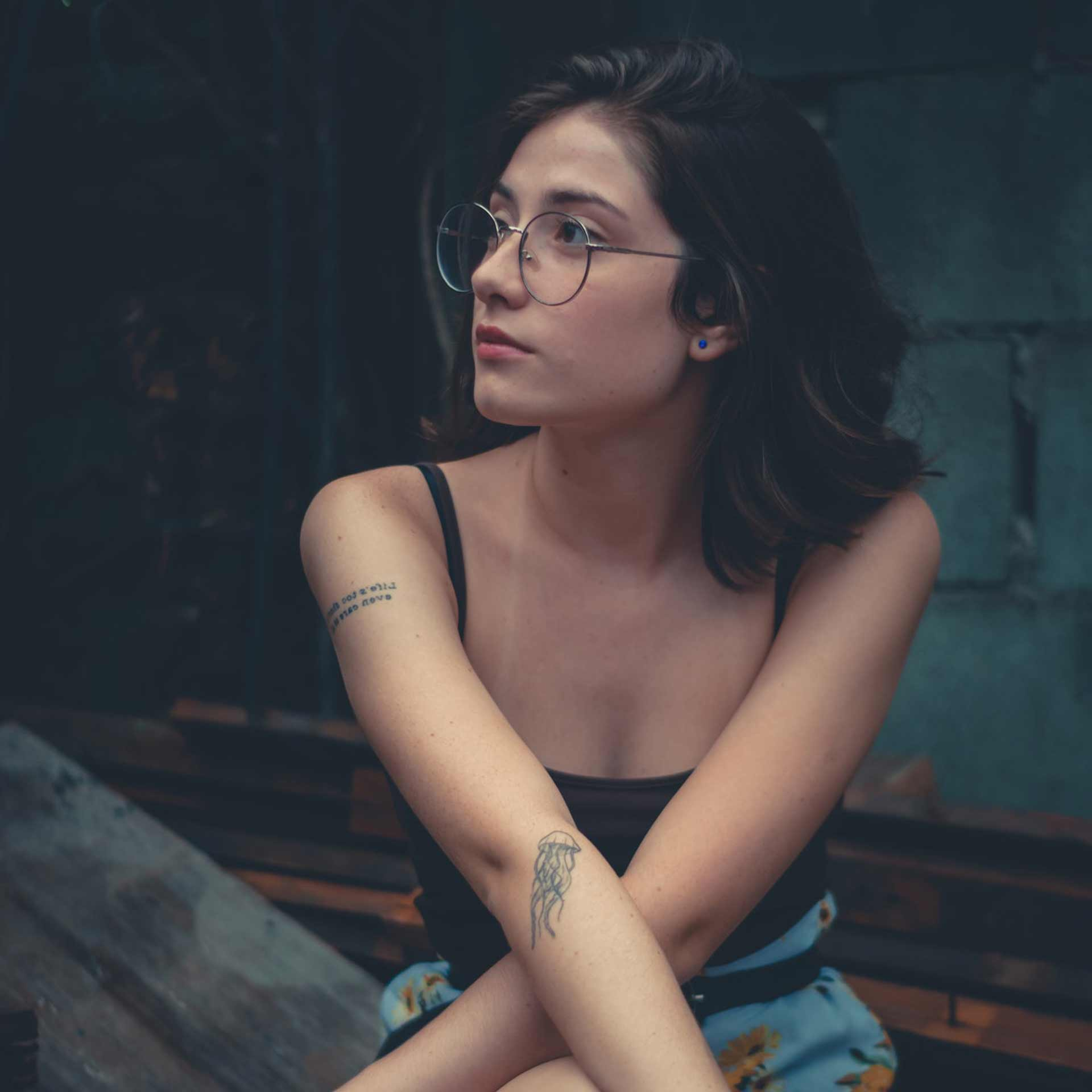 woman-wearing-eyeglasses-on-brown-wooden-plank-1845210